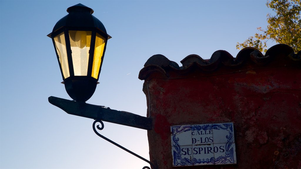 Uruguay featuring a sunset and signage