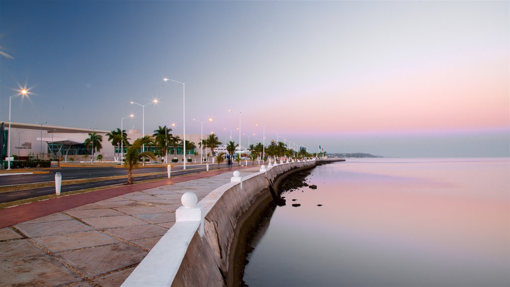 Campeche Waterfront Promenade featuring a sunset and a bay or harbor