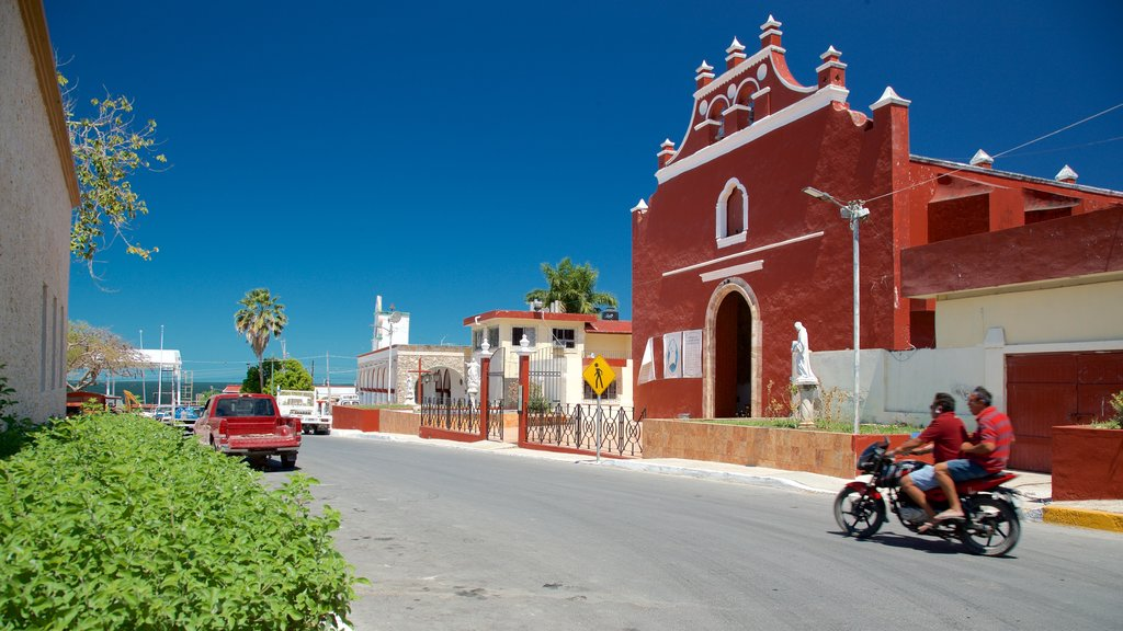 Lerma featuring motorbike riding and a small town or village