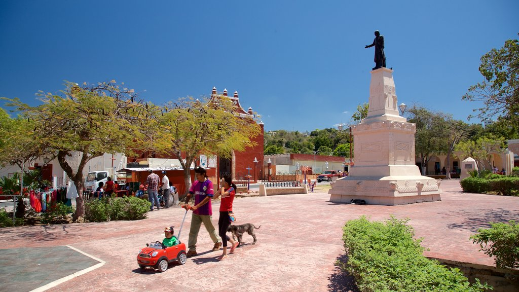 Lerma featuring a statue or sculpture and a garden as well as a family