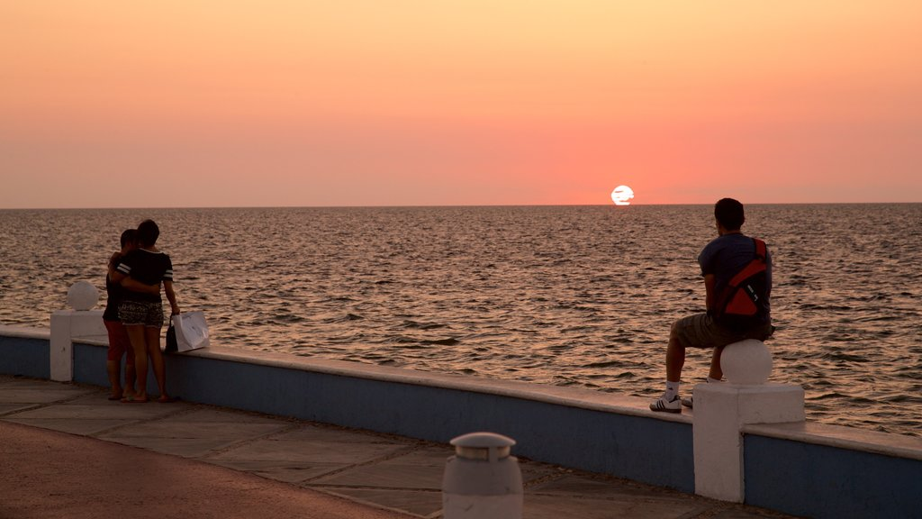 Campeche Waterfront Promenade featuring general coastal views and a sunset as well as a couple