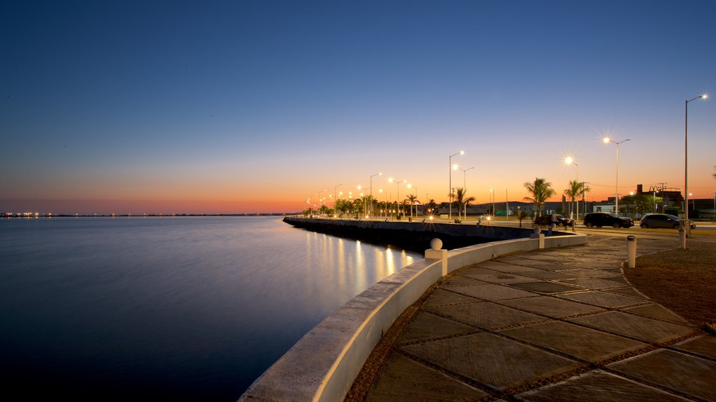 Campeche Waterfront Promenade which includes a bay or harbor and a sunset