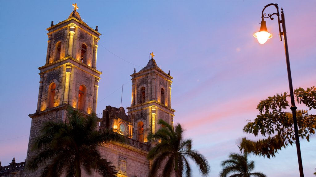 Cathedral of San Gervasio showing heritage elements and a sunset