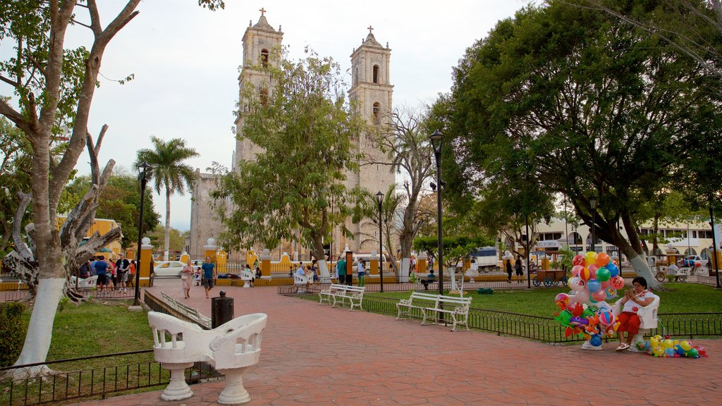 Cathedral of San Gervasio which includes a garden as well as a small group of people