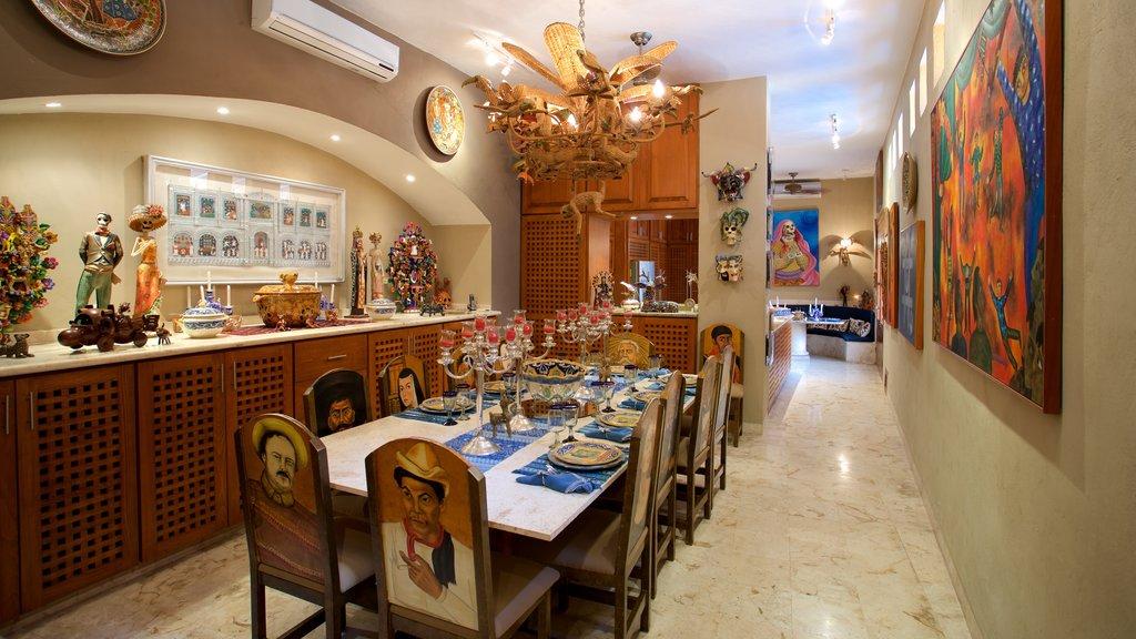 Casa de los Venados which includes a house, art and interior views