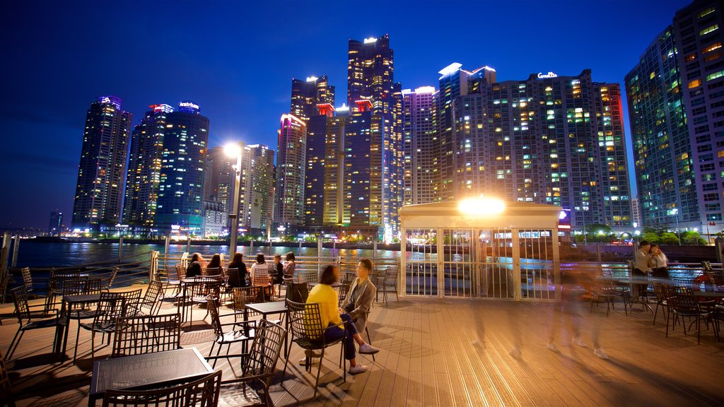 Busan showing a skyscraper, a city and outdoor eating