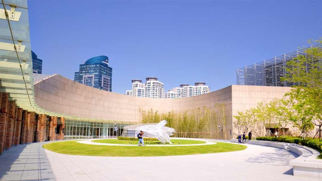 Shinsegae Centum City showing a high rise building, outdoor art and a city