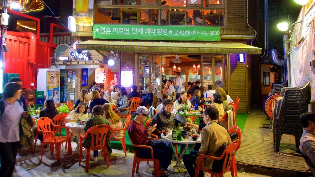 Busan mostrando escenas nocturnas y comer al aire libre y también un pequeño grupo de personas