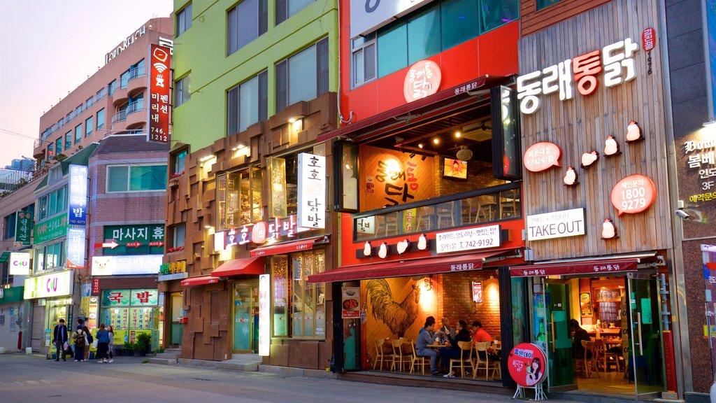Haeundae showing a city and signage