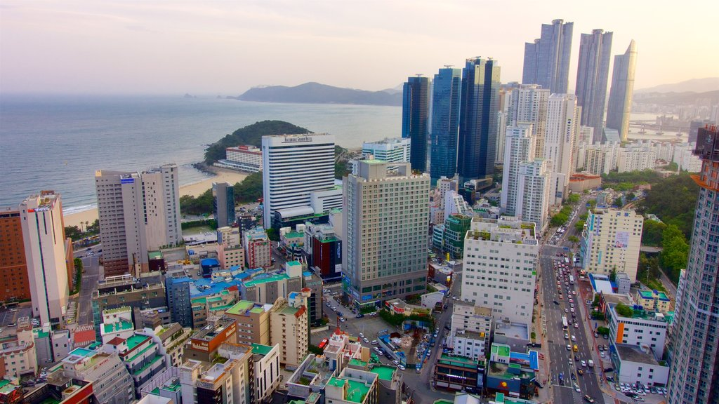 Haeundae which includes general coastal views, a sunset and a coastal town
