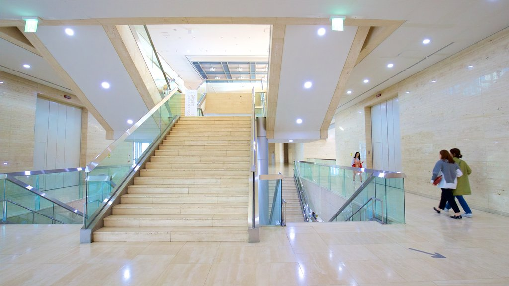Busan Museum of Art featuring interior views as well as a small group of people