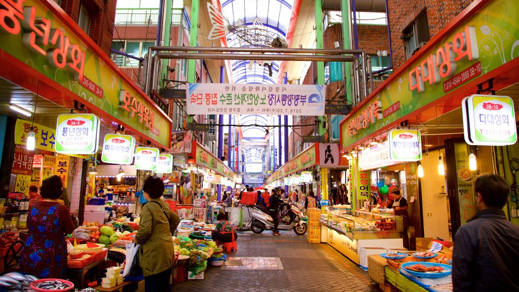 Gukje Market which includes markets, signage and food