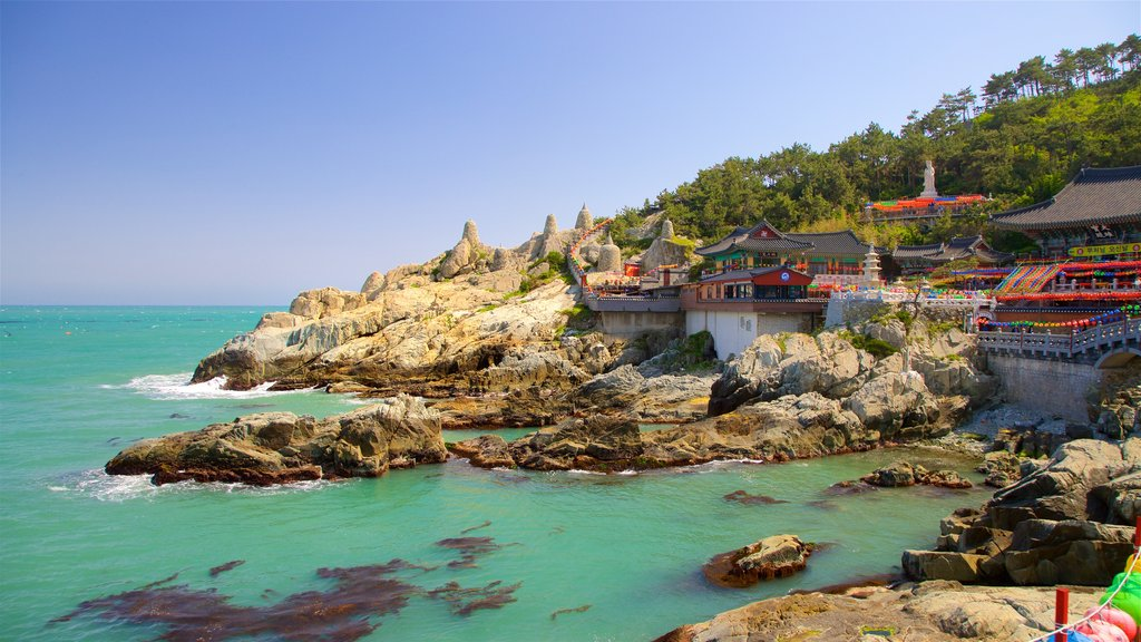 Haedong Yonggung Temple featuring general coastal views and rocky coastline