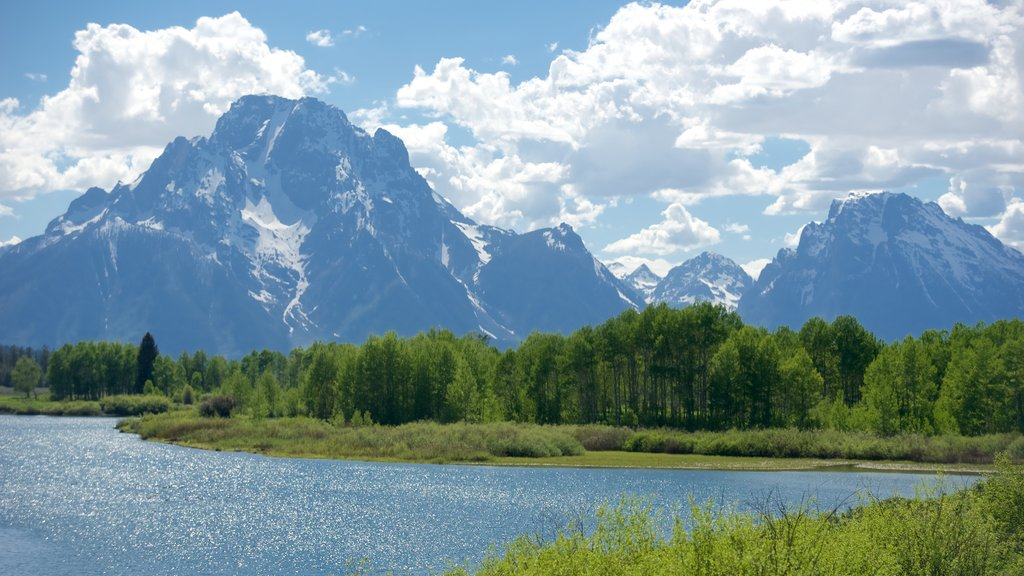 Oxbow Bend which includes a river or creek and mountains