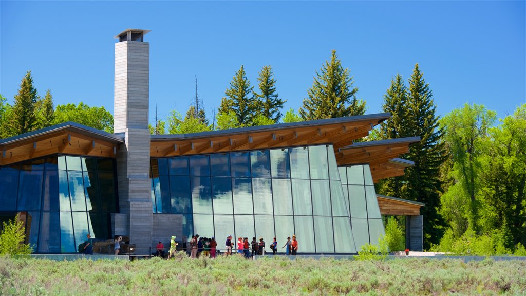 Jenny Lake Visitor Center which includes modern architecture as well as a small group of people