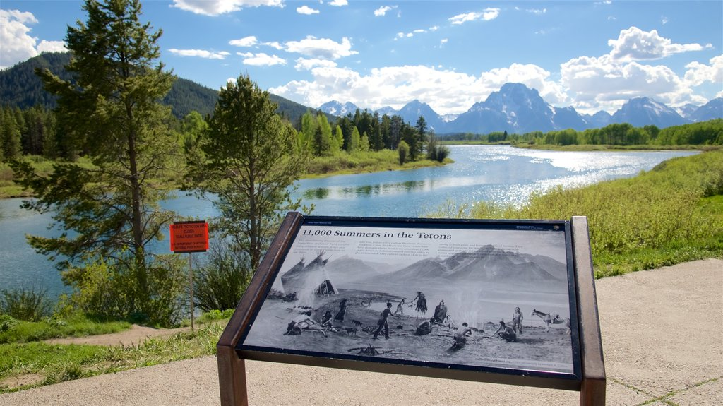 Oxbow Bend showing signage and a river or creek