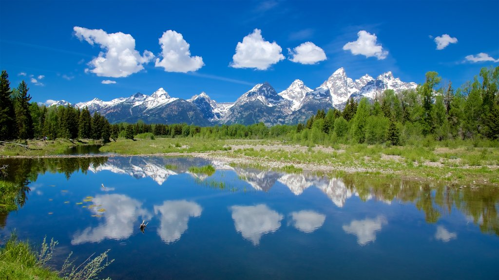 Schwabacher\'s Landing featuring mountains, a river or creek and tranquil scenes