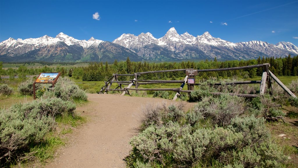Grand Teton National Park featuring signage, mountains and tranquil scenes
