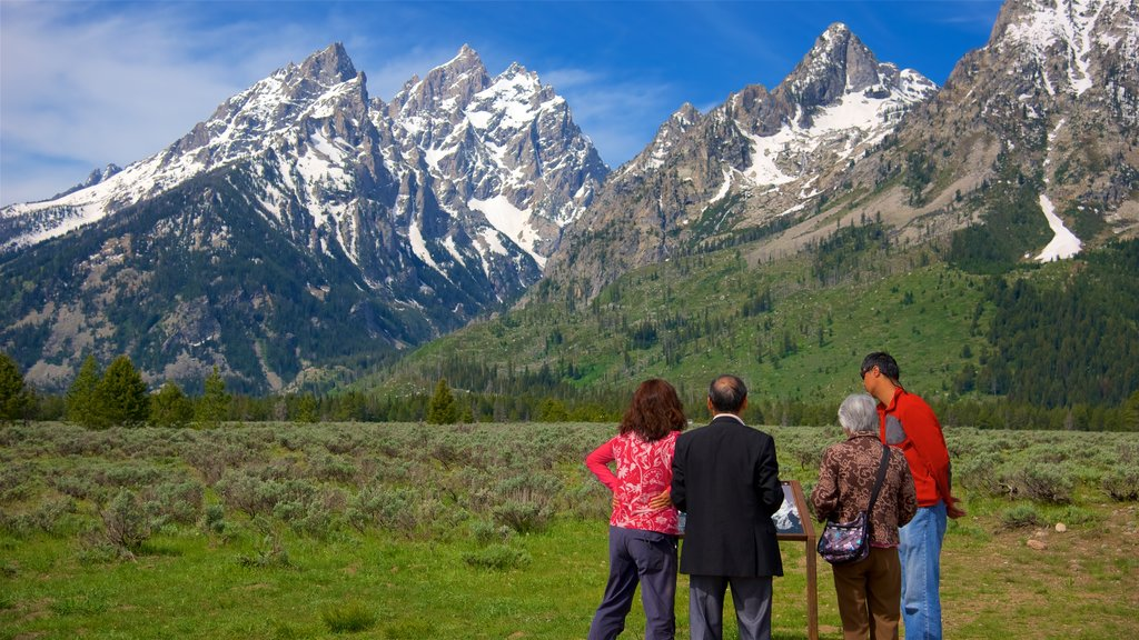 Grand Teton National Park which includes tranquil scenes and mountains as well as a small group of people