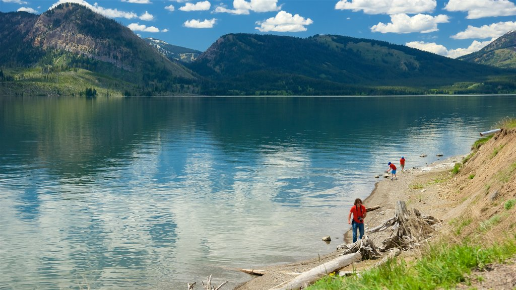 Jackson Lake featuring a lake or waterhole as well as a small group of people