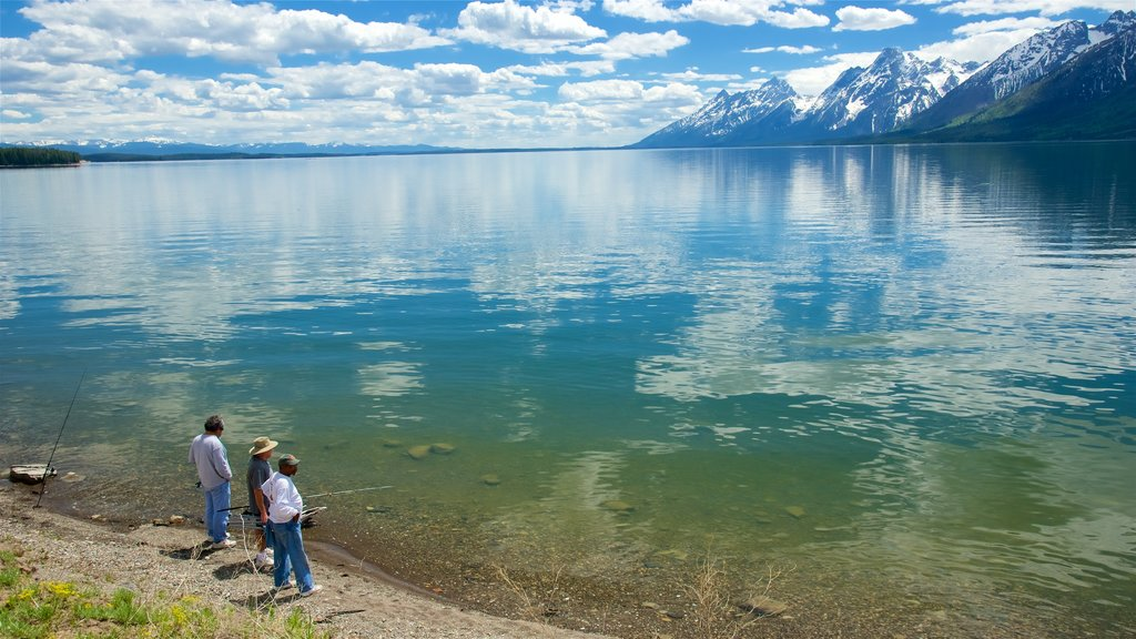 Jackson Lake showing a lake or waterhole and fishing as well as a small group of people