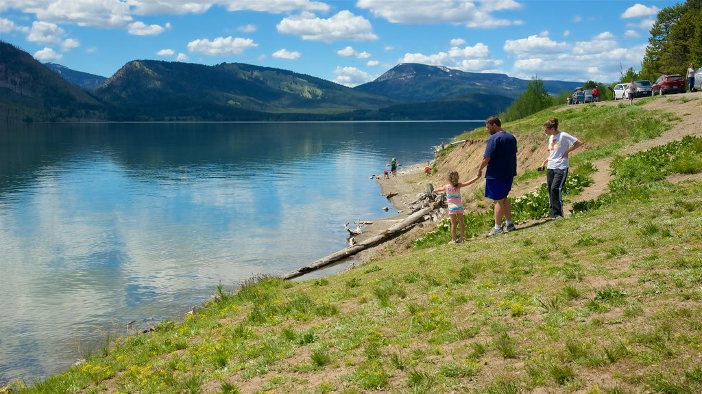 Jackson Lake which includes a lake or waterhole as well as a family