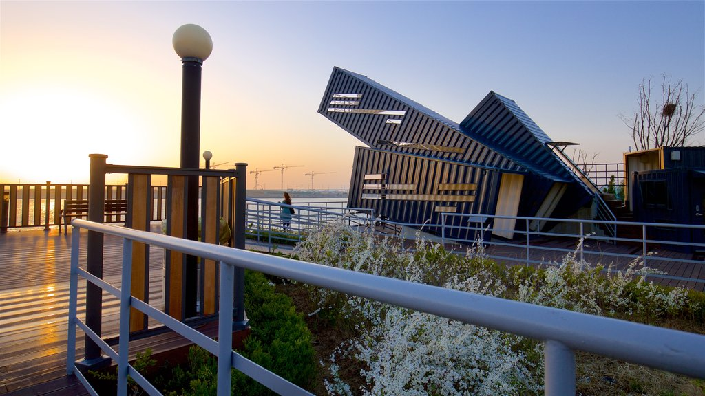 Incheon featuring a sunset, outdoor art and wildflowers
