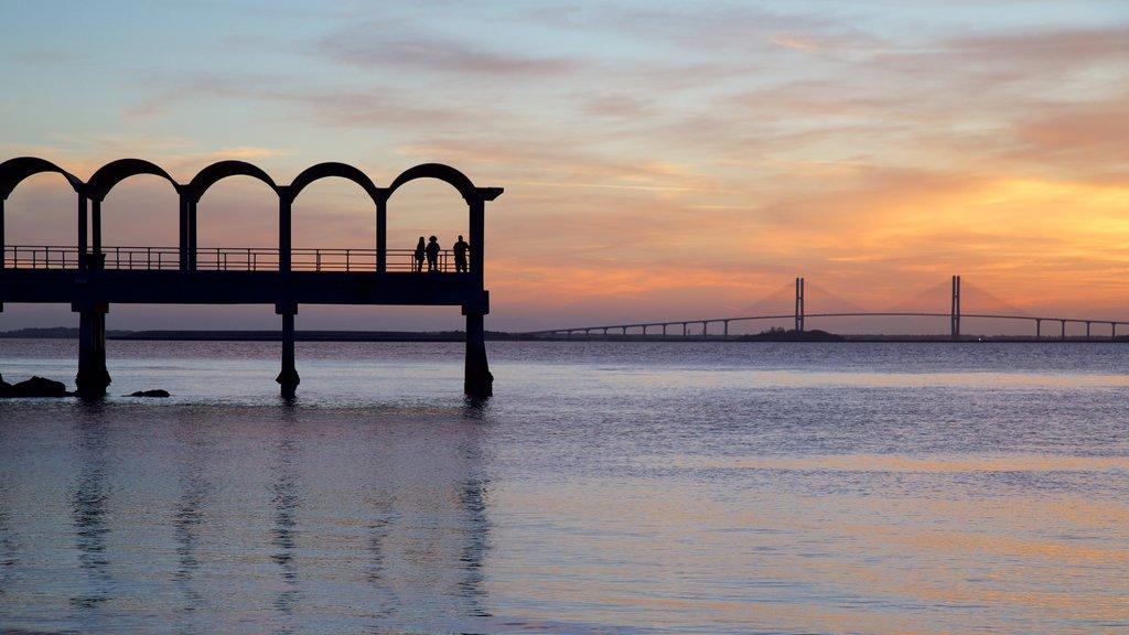 Driftwood Beach featuring a sunset, general coastal views and a bridge