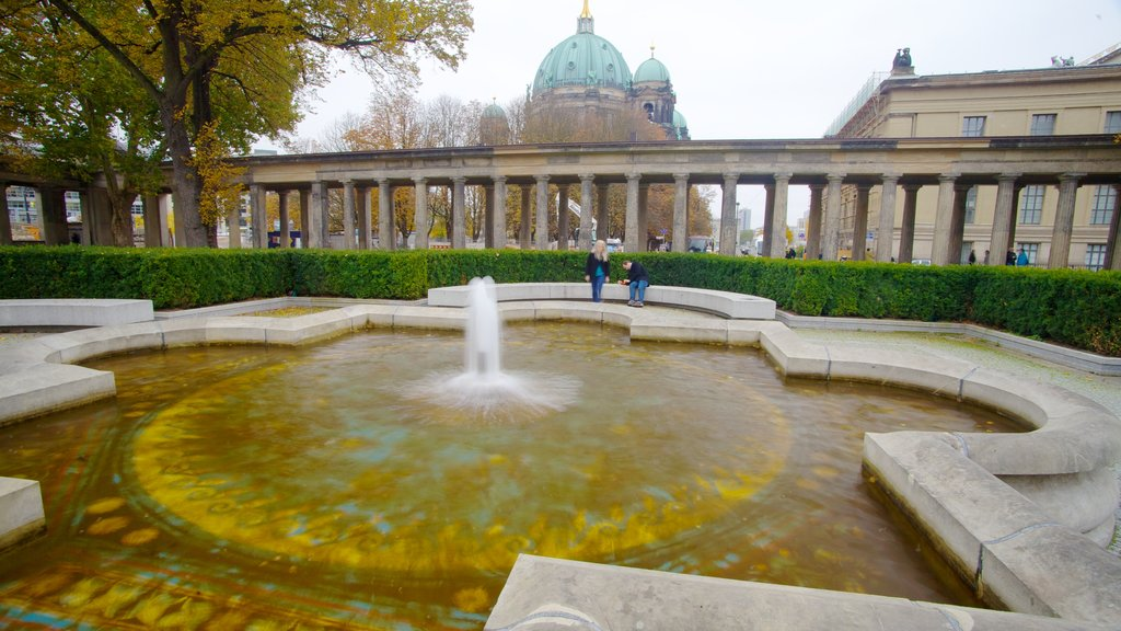 Museum Island which includes a city, a pool and a fountain