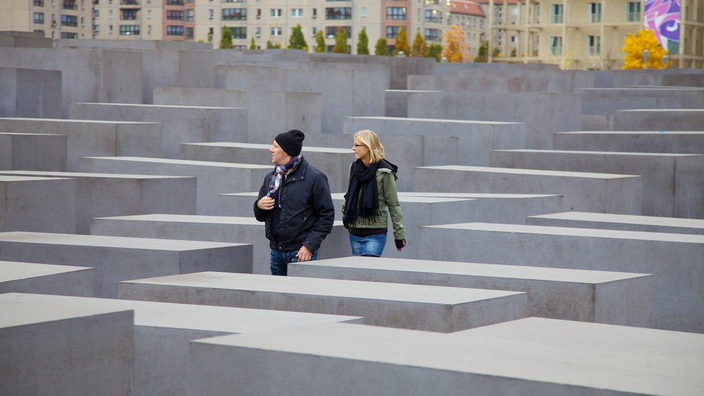 Holocaust Memorial which includes a memorial and a city as well as a couple