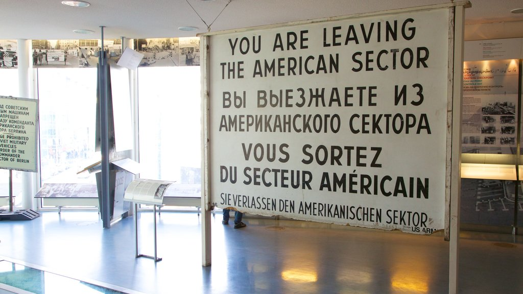Checkpoint Charlie Museum which includes signage and interior views