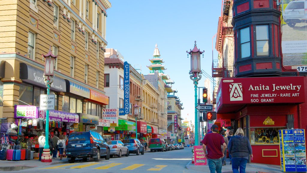 Chinatown showing a city and street scenes as well as a couple