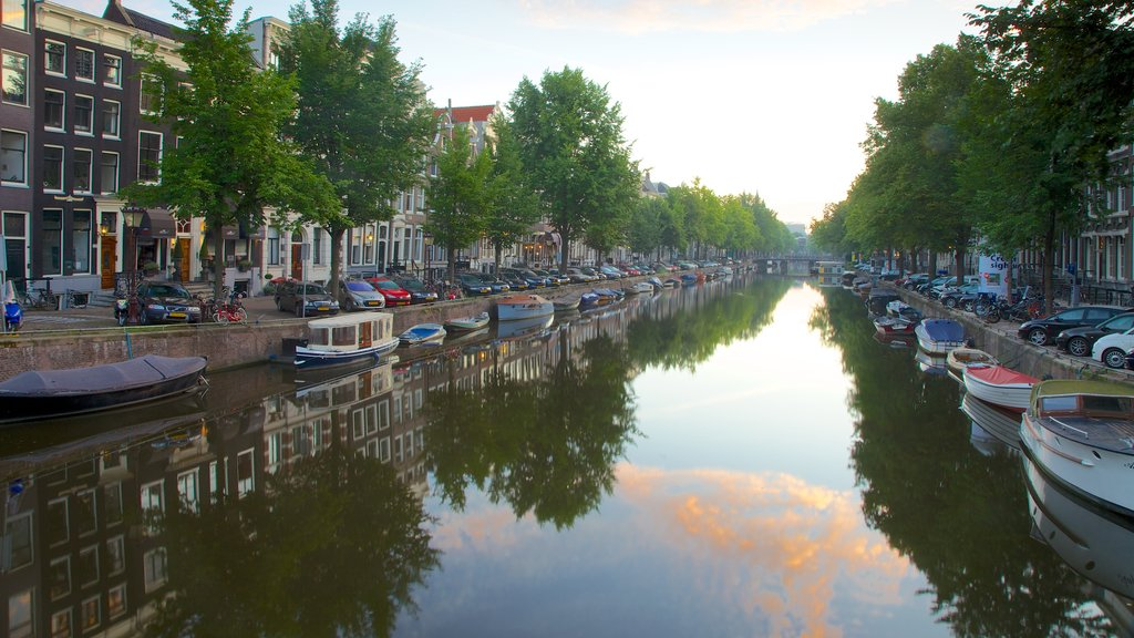 Amsterdam showing a river or creek, boating and a city