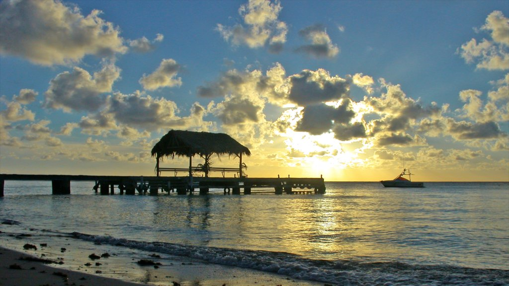 Trinidad which includes a sandy beach, tropical scenes and a sunset