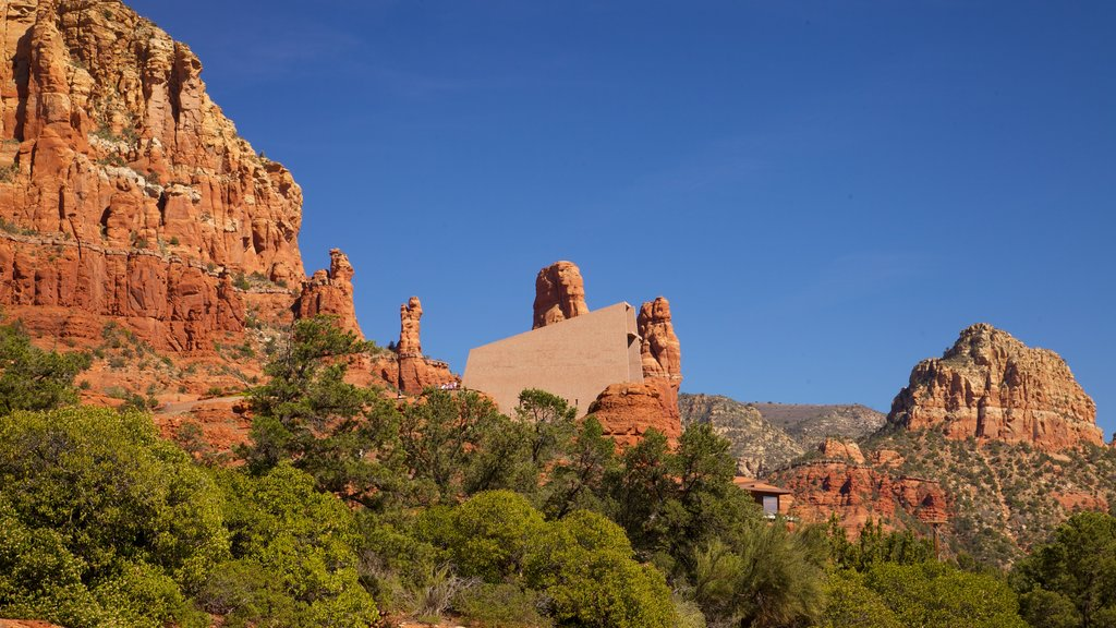 Sedona featuring general coastal views, a gorge or canyon and rugged coastline