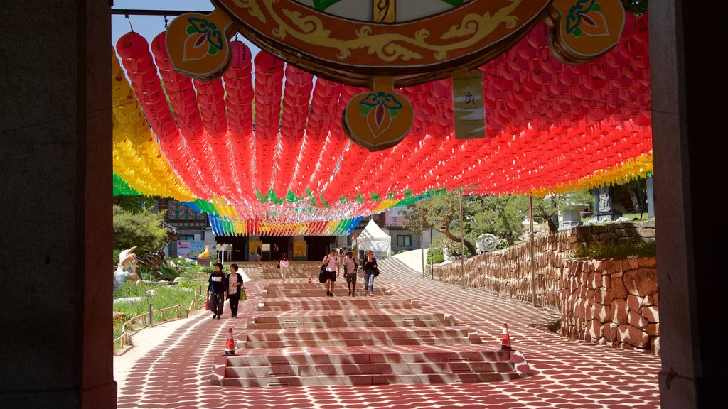 Bongeunsa Temple featuring outdoor art as well as a small group of people