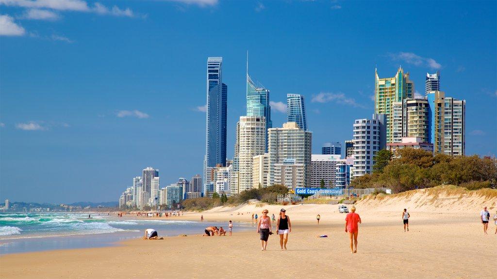Main Beach which includes a skyscraper, general coastal views and a beach