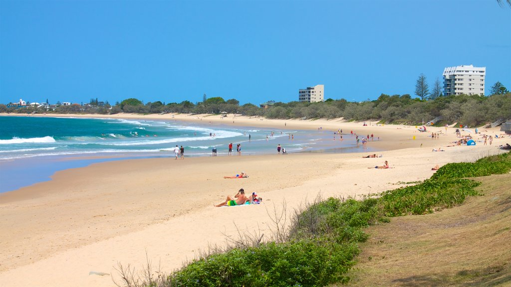 Mooloolaba showing a beach and general coastal views as well as a small group of people