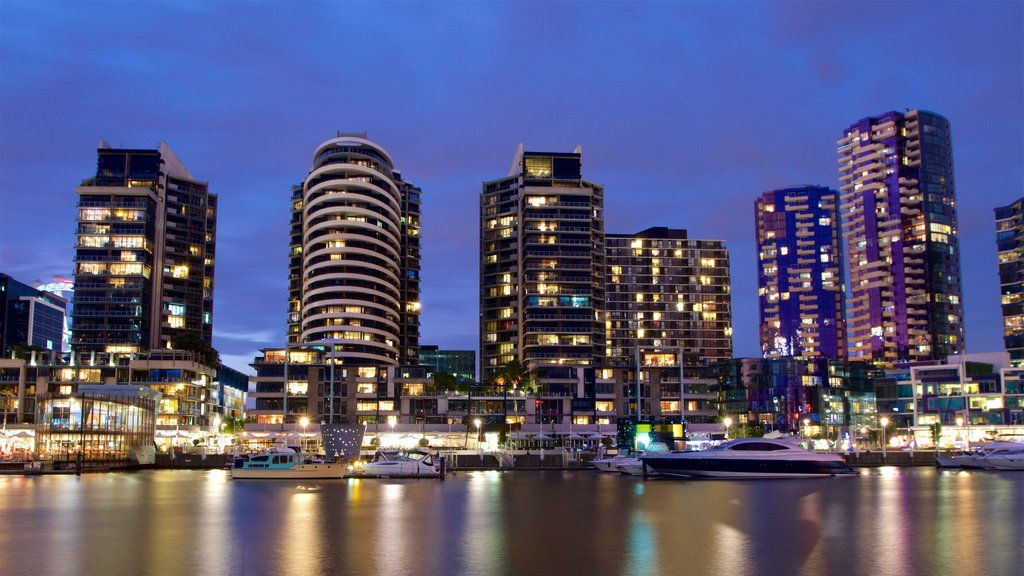 Docklands featuring a bay or harbor, night scenes and a skyscraper