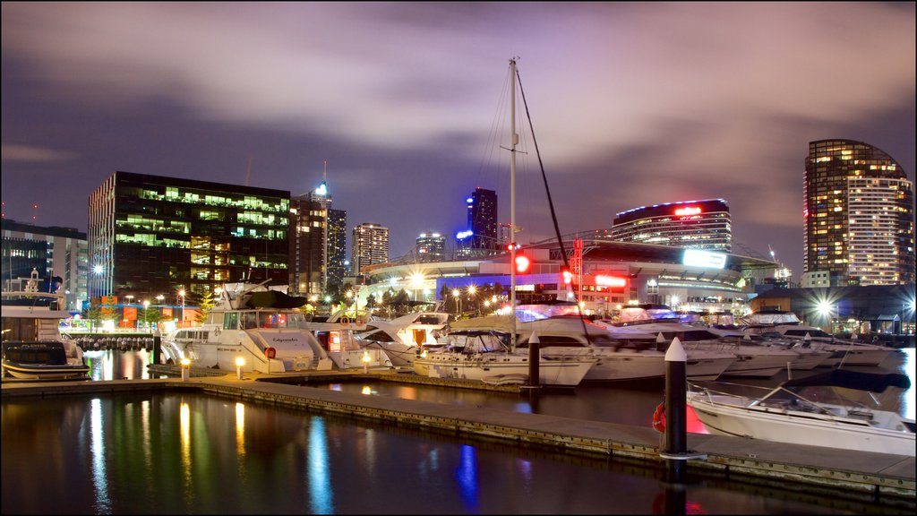 Docklands which includes night scenes, a bay or harbor and a city