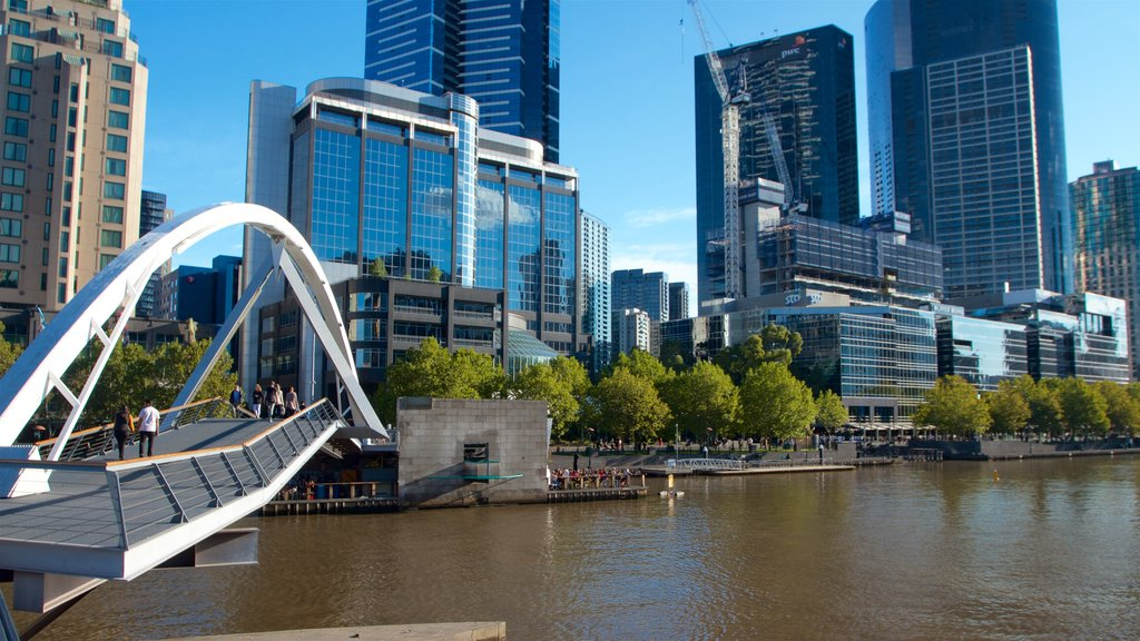 Southbank featuring a river or creek, a bridge and a skyscraper