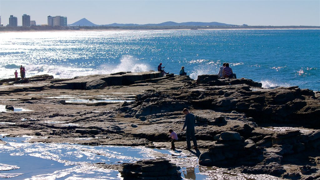 Mooloolaba showing general coastal views and rugged coastline as well as a small group of people