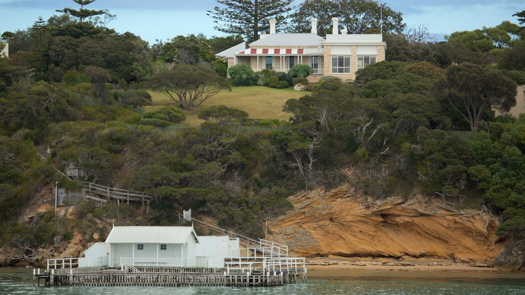 Portsea which includes general coastal views, rugged coastline and a house