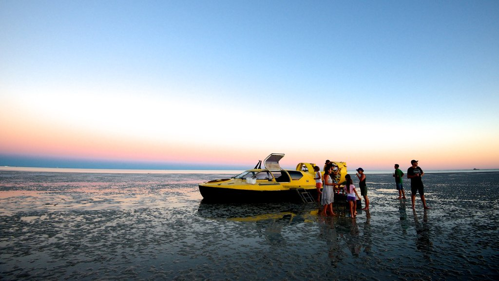 Broome featuring a sunset and general coastal views as well as a small group of people