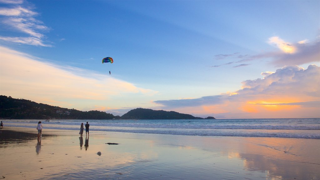 Patong showing a sandy beach, watersports and a sunset
