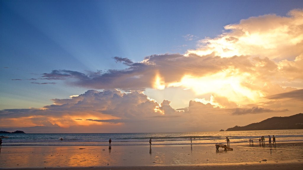 Patong showing a beach, a sunset and general coastal views