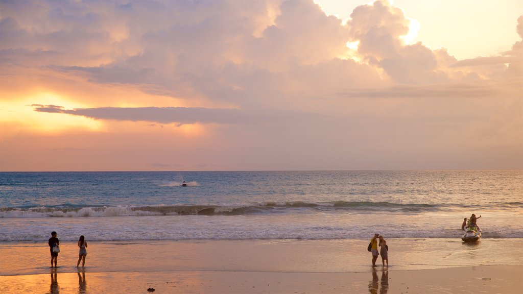 Patong which includes general coastal views, a sandy beach and a sunset