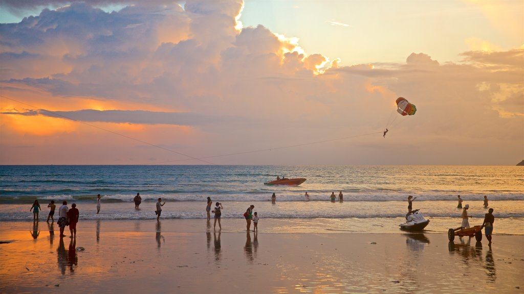 Patong showing a sunset, watersports and a beach