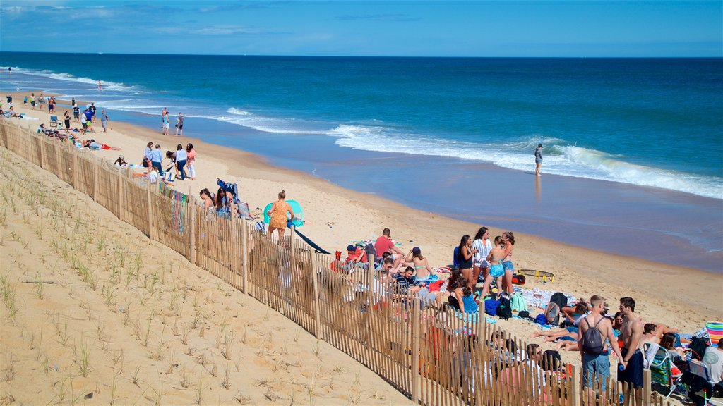 Montauk featuring general coastal views and a beach as well as a small group of people
