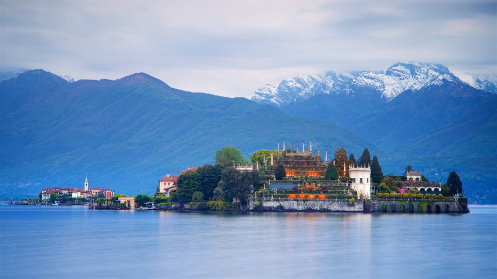 Lake Maggiore featuring a lake or waterhole, mountains and a small town or village